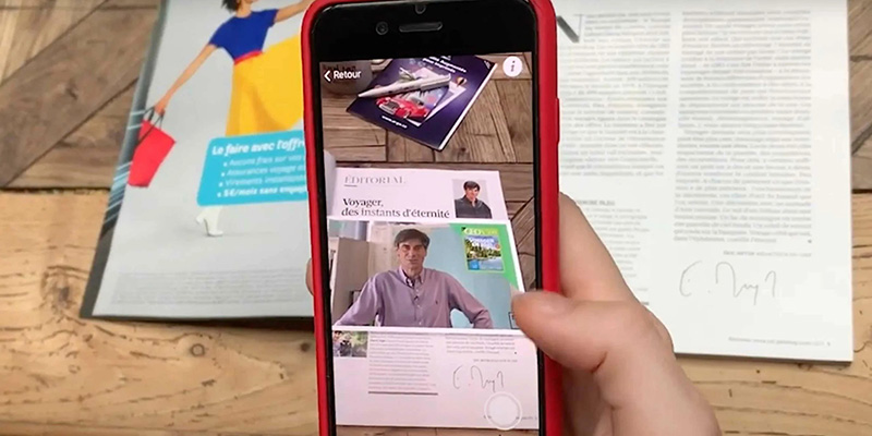 Overview of a smartphone scanning the magazine GEO