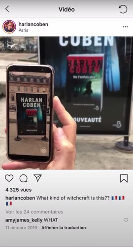 overview of a smartphone scanning a bus shelter poster with a book by Harlan Coben