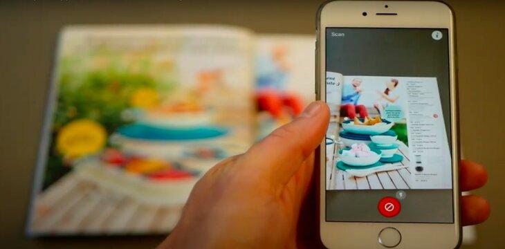 smartphone scanning a magazine